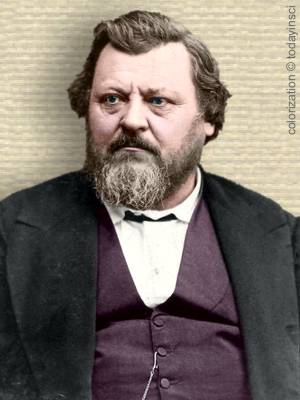 Portrait photo of Carl Vogt, upper body, facing forward, colorization © todayinsci