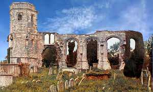 Postcard image of Holy Ghost Church ruins, tower, no roof, remains of wall with empty window arches, gravestones in foreground