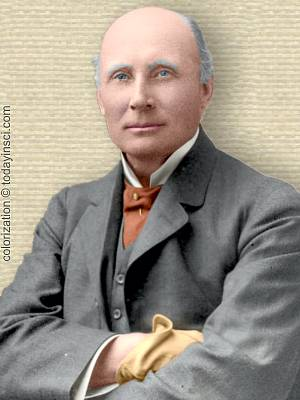 Photo of Alfred Whitehead, upper body, folded arms, facing forward. Colorization © todayinsci.com