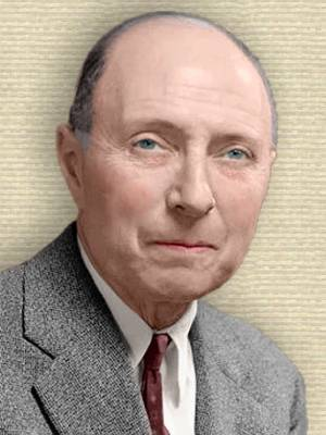 Photo of Eugene Wigner, head and shoulders facing front. Colorization by todayinsci.com