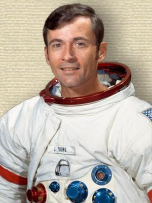 Studio photo of John Watts Young in space flight suit, upper body, facing forwards